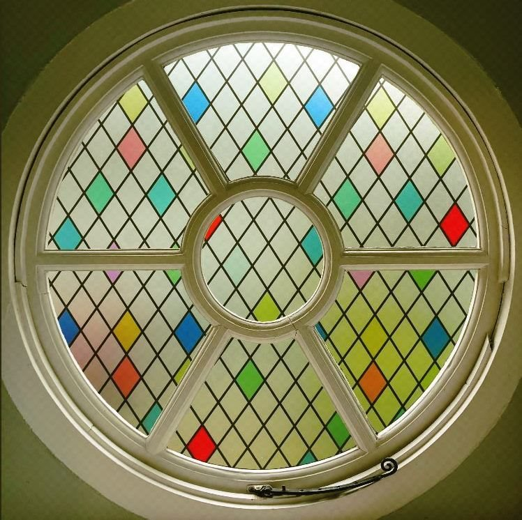 Harlequin Stained Glass Round Window